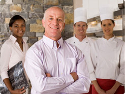 Restaurant owner who uses a payroll system to easily pay his employees